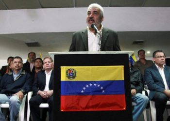 Angel Oropeza  member of the Venezuelan coalition of opposition parties  MUD   talks to the media during a news conference in Ca